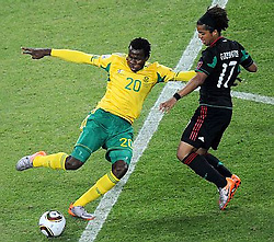 100611) -- JOHANNESBURG, June 11, 2010 (Xinhua) -- South Africa's Bongani Khumalo (L) vies with Mexico's Giovani Dos Santos during a group A match of the 2010 FIFA World Cup at Soccer City stadium in Soweto, suburban Johannesburg, on June 11, 2010. The match ended with a 1-1 tie. (Xinhua/Li Ga) (ly) (Credit Image: © Xinhua via ZUMA Wire)