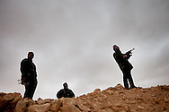 Rebel army volunteers prepare to fight forces loyal to Qadaffi in a town near Ras Lanuf  on March 3, 2011.