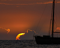 Sunset and Sailboat off Kona Beach, Big Island Hawaii. Image taken with Nikon D2xs and 80-400 mm VR lens (ISO 100, 400 mm, f/5.6, 1/500 sec).