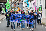 Climate activists from Extinction Rebellion attend a protest against the expansion of Stansted Airport on 29 August 2020 in Bishops Stortford, United Kingdom. The activists are calling on Manchester Airports Group to withdraw their appeal, for which planning permission was previously refused by Uttlesford District Council, to be able to expand Stansted Airport from a maximum of 35 million to 43 million passengers a year, as well as calling on the Government to halt all airport expansion in order to maintain its commitments under the Paris Agreement.