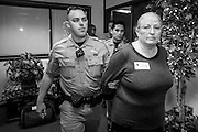 21 OCTOBER 2013 - PHOENIX, AZ:  CAROLYN COOPER, 67, from Tempe, AZ, is arrested by Arizona State Police after she staged a sit-in in the office of the Attorney General. She and other DREAM Act supporters are protesting the decision by Attorney General Horne to sue the Maricopa County Community College District to force the district to charge in-state tuition to the young people who qualify for the federal government deferred-action program.    PHOTO BY JACK KURTZ