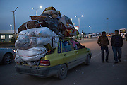 Syrian - Turkish border in Kilis, newly arrived refugee from Aleppo packed a Taxi to go to the busstation. Because Turkey is saturated with refugees, they will likely get no  help, no work, and no place in a refugee camp. Many refugees return to Aleppo after a few month in Turkey, a country that is now saturated with refugees.