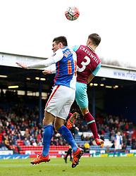 Aaron Cresswell of West Ham United challenges Ben Marshall of Blackburn Rovers   - Mandatory byline: Matt McNulty/JMP - 21/02/2016 - FOOTBALL - Ewood Park - Blackburn, England - Blackburn Rovers v West Ham United - FA Cup Fifth Round