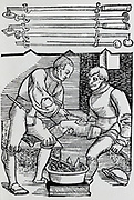 Cauterising a wound. Woodcut from a book on field surgery, 1593.