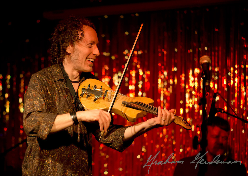 Violinist Tracy Silverman responds to one of guitarist Jack Silverman's licks in his solo.