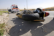 Israel, A motorbike lies on the road after a traffic collision Ambulance in the background