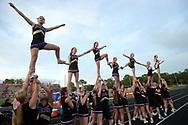 Winter Springs cheerleaders perform before a high school football game against Lake Mary in Lake Mary, Fla., Friday, Oct. 9, 2015. (Phelan M. Ebenhack via AP)