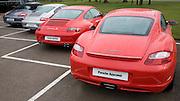 Porsche cars on dealership forecourt
