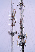 Cellular antennas on guyed towers in Buenos Aires, Argentina. <br /> <br /> Editions:- Open Edition Print / Stock Image