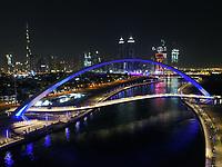 Aerial view of the Tolerance pedestrian Bridge in Dubai at night in United Arab Emirates.