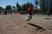 A boy participates in a relay sack race during the last day of activities at the child-friendly space located in Alim Tepe School (in Osh, Kyrgyzstan), established and supported by Save the Children. The closing celebrations included a sports competition, games and a cake.