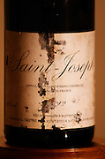 Closeup of An old bottle of Saint Joseph 1992 by Jean-Louis Grippat with torn and mouldy label. JL Grippat has been sold to Guigal.  Saint Joseph, Rhone, France, Europe