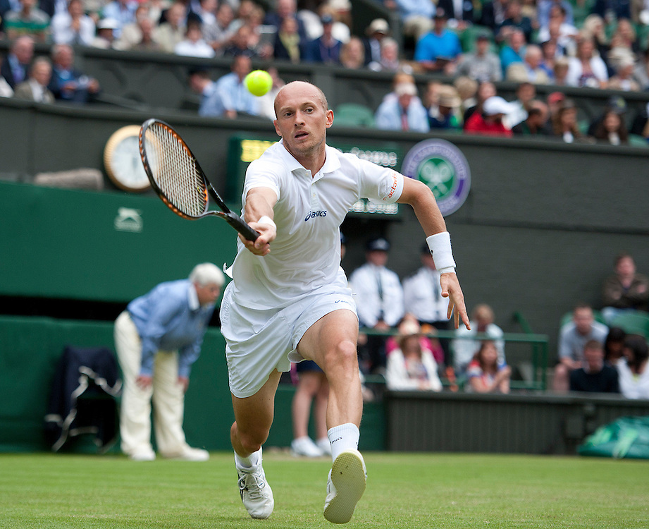 Nikolay Davydenko RUS in action today during his defeat by Andy Murray GBR (4) in their Gentlemen's Singles First Round match - Andy Murray GBR (4) def Nikolay Davydenko RUS 6-1 6-1 6-4..Tennis - Wimbledon Lawn Tennis Championships - Day 2 - Tuesday 26th June 2012 -  All England Lawn Tennis and Croquet Club - Wimbledon - London - England...