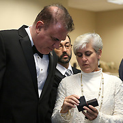 Florida Congressman Alan Grayson looks at the wedding rings prior to serving as the ring bearer for Osceola County Commissioner Cheryl Grieb and partner Patti Daugherty during Osceola County Florida's first gay marriage which started just after midnight on January 6, 2015 at the Osceola County courthouse in Kissimmee, Florida.  (AP Photo/Alex Menendez)