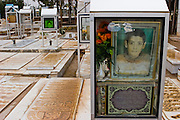Pictures of deceased Iranians are displayed on graves in a cemetery in Maybod, Iran.