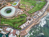 Aerial view of Green Point stadium, coastal road and buildings, Cape Town, South Africa.