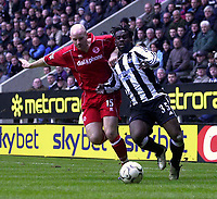 Photo. Glyn Thomas.<br /> Newcastle United v Middlesbrough. Premiership.<br /> St James' Park, Newcastle. 21/02/2004.<br /> Boro's Danny Mills (L) battles for the ball with Newcastle's Olivier Bernard.