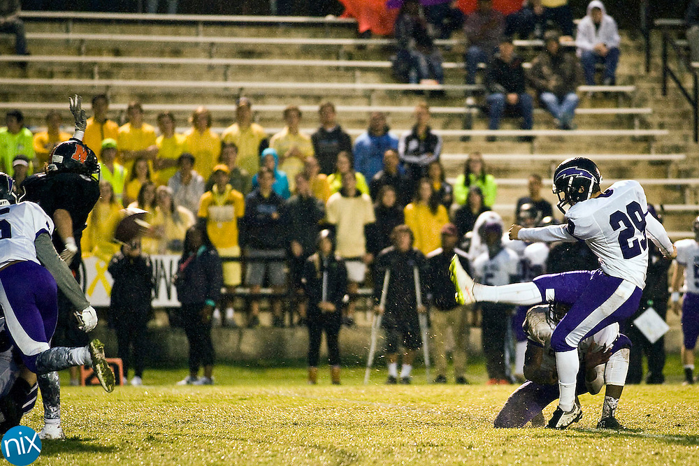 Chargers kicker John Brosnahan  (29, right) kicks a field goal to give the Chargers a 3 to 0 lead during the Cox Mill Chargers at Northwest Cabarrus Trojans high school football game on Friday night.