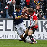 NLD/Rotterdam/20100919 - Voetbalwedstrijd Feyenoord - Ajax 2010, Luis Suarez in duel met Stefan de Vrij