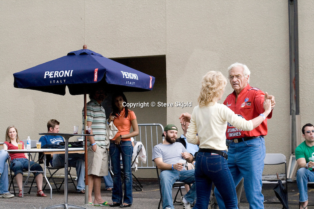 Sporty older couple age 66 and 40 dancing in beer garden. Grand Old Day Street Fair St Paul Minnesota USA
