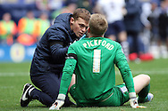 Preston North End Goalkeeper Jordan Pickford receives treatment after a clash of heads. Skybet football league championship match, Preston North End v Cardiff City at the Deepdale stadium in Preston, Lancashire on Saturday 17th October 2105.<br /> pic by Chris Stading, Andrew Orchard sports photography.