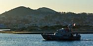 Coast Guard 47 foot Motor Life boat returning to harbor at sunrise, Morro Bay, California