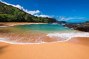 Sand and surf at Lumahai Beach, Island of Kauai, Hawaii