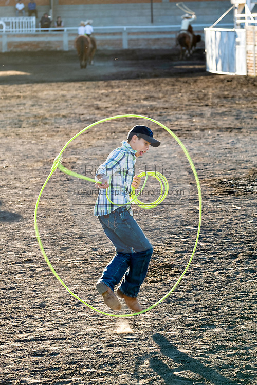 A young Charro practices roping tricks during a family charro practice session in the Jalisco Highlands town of Capilla de Guadalupe, Mexico.