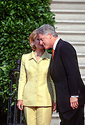US President Bill Clinton and first lady Hillary Clinton chat as they wait for the arrival of Czech President Vaclav Havel on the South Lawn of the White House September 16, 1998 in Washington, DC.