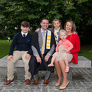 """25.08.2016          <br />  Faculty of Business, Kemmy Business School graduations at the University of Limerick today. <br /> <br /> Attending the conferring was Diploma in Management graduate, Eoin Colgan with his family, Callum, Ellie, Amelie Colgan and Andrea Deverell. Picture: Alan Place.<br /> <br /> <br /> As the University of Limerick commences four days of conferring ceremonies which will see 2568 students graduate, including 50 PhD graduates, UL President, Professor Don Barry highlighted the continued demand for UL graduates by employers; """"Traditionally UL's Graduate Employment figures trend well above the national average. Despite the challenging environment, UL's graduate employment rate for 2015 primary degree-holders is now 14% higher than the HEA's most recently-available national average figure which is 58% for 2014"""". The survey of UL's 2015 graduates showed that 92% are either employed or pursuing further study."""" Picture: Alan Place"""
