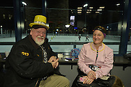 East Meadow, New York, USA. December 31, 2014. BILL TREMBLAY, of Huntington, is with his his wife NANCY TREMBLAY, a runner who will participate in a 5K New Year's Eve DASH to support the Long Island Council on Alcoholism and Drug Dependence (LICADD) at the Twin RInks Ice Center at Eisenhower Park in Long Island. Behind them is an outdoor skating rink. A Skatin' New Year's Eve event started hours earlier and a New Year's Eve Party, open to runners, family and friends continued until 2:30 a.m.