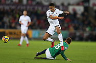 Kyle Naughton of Swansea city jumps over a tackle from Sam Field of West Bromwich Albion. Premier league match, Swansea city v West Bromwich Albion at the Liberty Stadium in Swansea, South Wales on Saturday 9th December 2017.<br /> pic by  Andrew Orchard, Andrew Orchard sports photography.