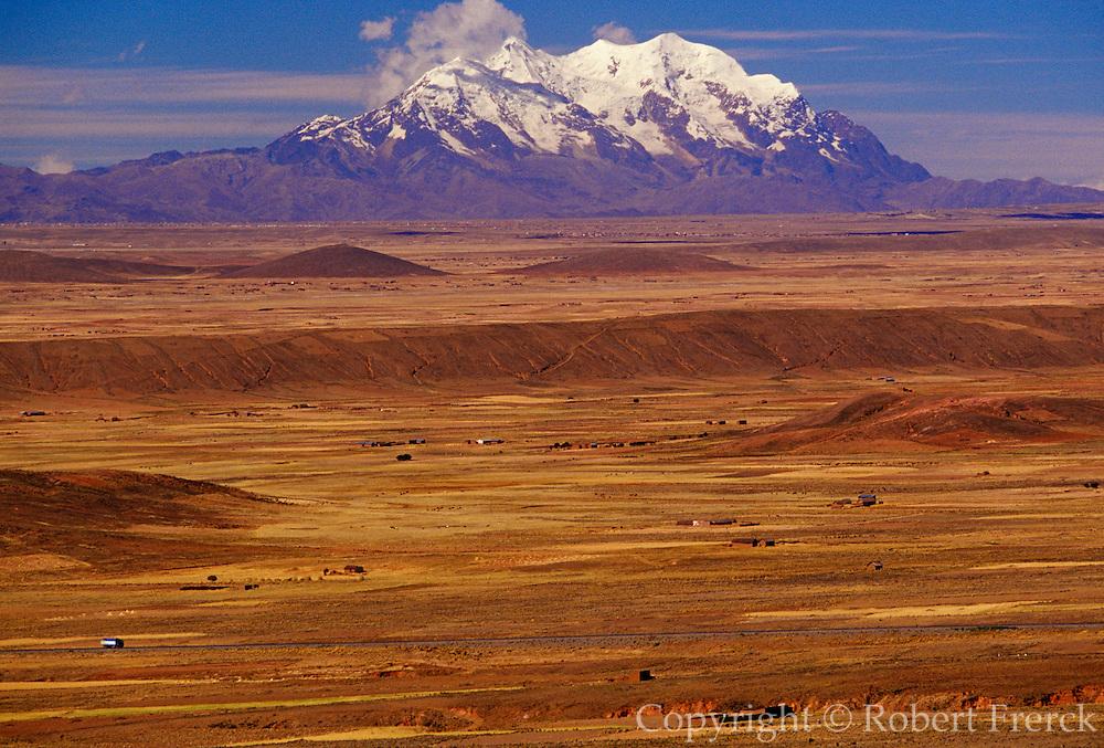 BOLIVIA, ALTIPLANO view across the 14,000 foot high altiplano toward Illimani Mountain, 6439m, in the  Cordillera Real range south of La Paz