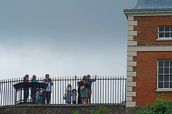 © Licensed to London News Pictures 13/08/2021. <br /> Greenwich, UK. Sightseers stand next to the Royal Observatory under a grey sky. A warm but cloudy day as people get out and about in Greenwich Park, London today enjoying some normality after the Coronavirus pandemic in the UK.<br /> Photo credit:Grant Falvey/LNP