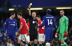 Refree Anthony Taylor shows Chelsea's Tiemoue Bakayoko a yellow card for a foul during the Premier League match at Stamford Bridge, London.
