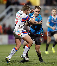Salford Red Devils' Lee Mossop is tackled by Wakefield Trinity's Kyle Wood during the Betfred Super League match at Belle Vue Stadium, Salford.