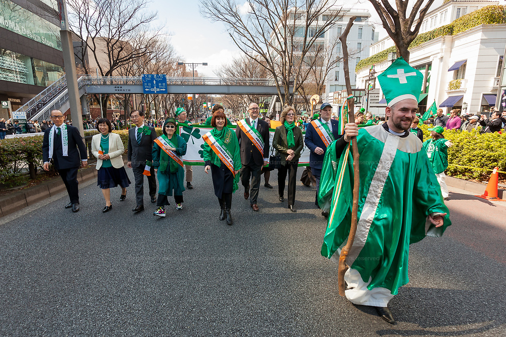 """A man dressed as St. Patrick leads the 27th Saint .Patrick's Day Parade in Omotesando, Tokyo, Japan. Sunday March 17th 2019. Started in 1992 by the Irish Network, Japan, and supported by the Embassy of Ireland,; the parade, along with the """"I Love Ireland Festival"""" held nearby is Asia's  largest Irish event."""