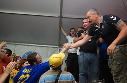 Milorad Krivokapic of Cimos Koper and fans celebrate  after the handball match between RK Cimos Koper (SLO) and SL Benfica (POR) in return final match of EHF Challenge Cup, on May 22, 2011 in Tent at Arena Bonifika, Koper, Slovenia. Koper defeated Benfica 31-27 and became Euro Challenge Champion 2011. (Photo By Vid Ponikvar / Sportida.com)