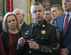 March 15, 2019 - Washington, District of Columbia, U.S. - Sheriff Michael A. Lewis of Wicomico County, Maryland makes a statement prior to United States President Donald J. Trump signing the veto statement of the bill passed by Congress to to block the national emergency he declared earlier to fund the long-delayed southern border wall in the Oval Office of the White House in Washington, DC on Friday, March 15, 2019. US Secretary of Homeland Security (DHS) Kirstjen Nielsen looks on from left  (Credit Image: © Ron Sachs/CNP via ZUMA Wire)
