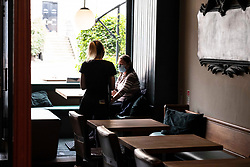 """Pictured: Adrianna Comoletto has lost none of her servis skills during the lockdown.<br /> <br /> The New Town Fox on Edinburgh's Dundas Street was open for business today for the first time in months like many bars and resaurants in Scotland.<br /> <br /> Manager Ethan Walch was pleasantly pleased to see so many customers stopping in for a meal or other refreshments. Ethan said: """"It felt like a quiet Wednesday before the pandemic.  Hopefully things will pick up more as customers see the precautions in place to avoid a second wave of Covid 19."""""""