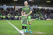 Mascot with Forest Green Rovers Joseph Mills(23) during the EFL Sky Bet League 2 match between Forest Green Rovers and Swindon Town at the New Lawn, Forest Green, United Kingdom on 21 December 2019.