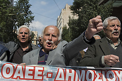 March 27, 2019 - Athens, Greece - Pensioners march to the prime minister's office at Maximos Mansion shouting slogans against austerity and cuts in social security. Pensioners unions took to the streets to protest over pension cuts and demand return of their slashed pensions, as their income has been shrinking since Greece entered the bailout deals in 2010. (Credit Image: © Nikolas Georgiou/ZUMA Wire)