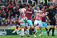 Joe Allen of Stoke battles with Hacard Nordtveit of West Ham utd (c).  Premier league match, Stoke City v West Ham Utd at the Bet365 Stadium in Stoke on Trent, Staffs on Saturday 29th April 2017.<br /> pic by Bradley Collyer, Andrew Orchard sports photography.