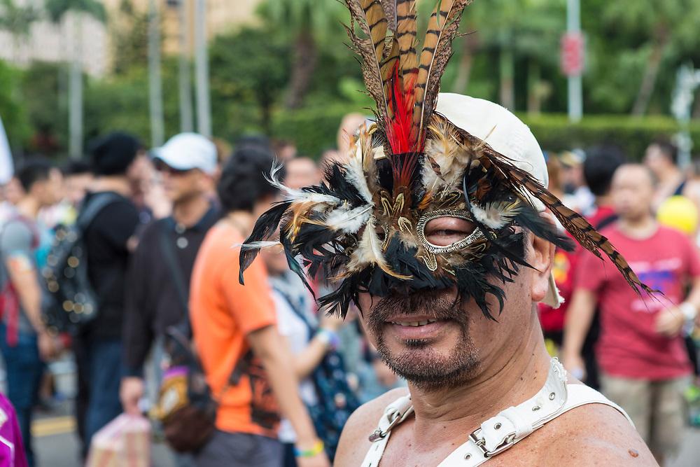 """A masked marcher poses for a photo at the  LGBT Pride festival. The annual march through Taipei's city streets is the largest in Asia, with well over 50 000 people taking part. The 2014 event had the theme """"Walk in Queer's Shoes"""", to encourage the wider community to lend their support for equal marriage rights."""