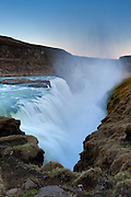 "The Hvítá River drops 69 feet (21 meters) into a narrow canyon at Gullfoss, one of the most visited waterfalls in Iceland. Gullfoss means ""golden falls."""