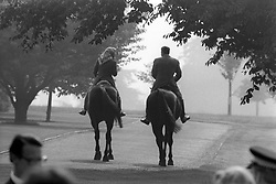 Queen Elizabeth II and American President Ronald Reagan out riding in Windsor Home Park. The President was in the saddle of Centennial, the eight-year-old gelding given to the Queen by the Canadian mounties in her Silver Jubilee year. The Queen is riding her horse Burmese.