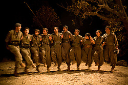 PKK female guerillas join male members to perform folk dance during filming of their struggle in Qandil Mountains, Iraqi Kurdistan. Besides their guerilla operation, PKK's social work ranges from running a hospital to making their own film.