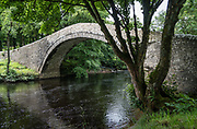 Ivelet bridge, River Swale, Swaledale. We followed the River Swale via meadows, woods, and villages, on our walk from Keld to Reeth in Yorkshire Dales National Park, England, United Kingdom, Europe. England Coast to Coast hike day 8 of 14. [This image, commissioned by Wilderness Travel, is not available to any other agency providing group travel in the UK, but may otherwise be licensable from Tom Dempsey – please inquire at PhotoSeek.com.]