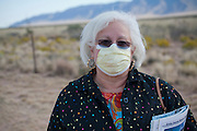 "A woman visiting the openhouse at Site Trinity, ground zero, on the White Sands Missile Range in S. New Mexico. Site of the world's first atomic explosiion on August 6, 1945. The atomic bomb was developed by the Manhatten Project. The Manhattan Project refers to the effort during World War II by the United States, in collaboration with the United Kingdom, Canada, and other European physicists, to develop the first nuclear weapons. Formally designated as the Manhattan Engineering District (MED), it refers specifically to the period of the project from 1942-1946 under the control of the U.S. Army Corps of Engineers, under the administration of General Leslie R. Groves, with its scientific research directed by the American physicist J. Robert Oppenheimer. The project succeeded in developing and detonating three nuclear weapons in 1945: a test detonation on July 16 (the Trinity test) near Alamogordo, New Mexico; an enriched uranium bomb code-named ""Little Boy"" detonated on August 6 over Hiroshima, Japan; and a plutonium bomb code-named ""Fat Man"" on August 9 over Nagasaki, Japan. (http://en.wikipedia.org/wiki/Manhattan_Project)"