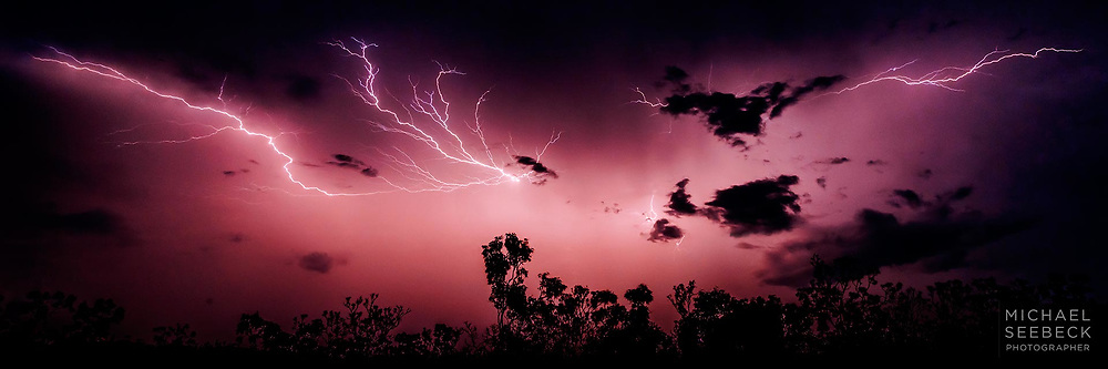 'Crawler' lightning flickers across the sky as a thunderstorm recedes into the distance, in the Top End of the Northern Territory.<br /> <br /> Code: HATD0015<br /> <br /> Limited Edition of 125 Prints